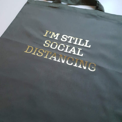 khaki tote with gold print I'm still social distancing slogan