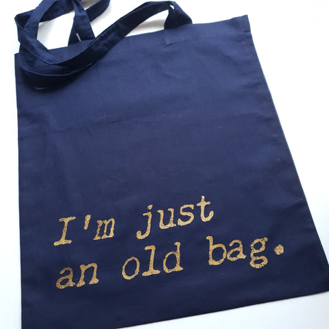 Tote bag with gold im an old bag slogan