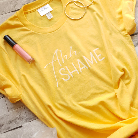Yellow unisex t with the ahh shame slogan in white ink.