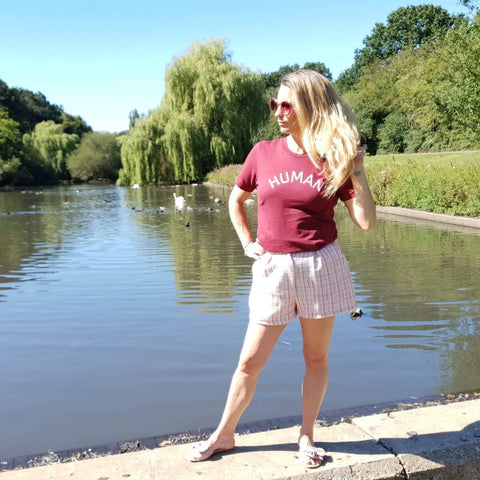 Cardinal red unisex t with the large HUMAN slogan in white ink. T tucked into pink and white shorts completing the look.