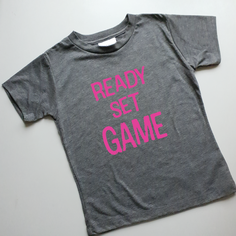 light grey kids tee with pink ink ready set game slogan print