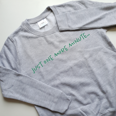 light grey sweatshirt with green ink just one more minute slogan print
