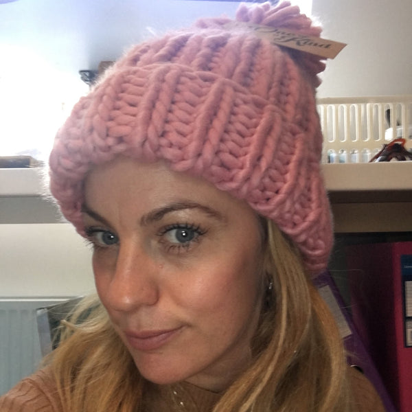 Paula wearing the dusty pink oversized hand knitted beanie.