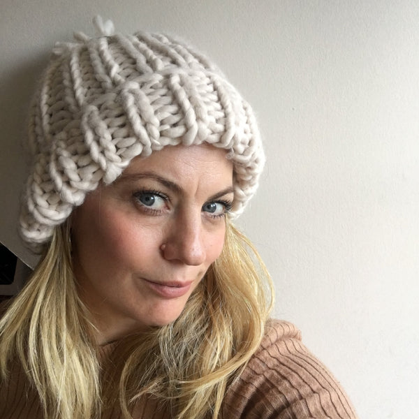 Paula wearing an oatmeal oversized hand knitted beanie.