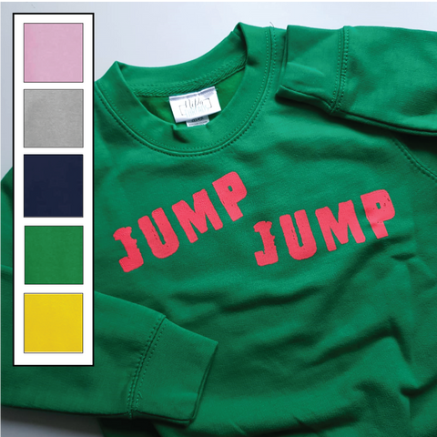 Kelly green kids unisex jumper with the jump jump slogan in glow coral ink.