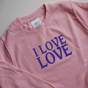 baby pink adult unisex sweatshirt with blue ink I love love slogan