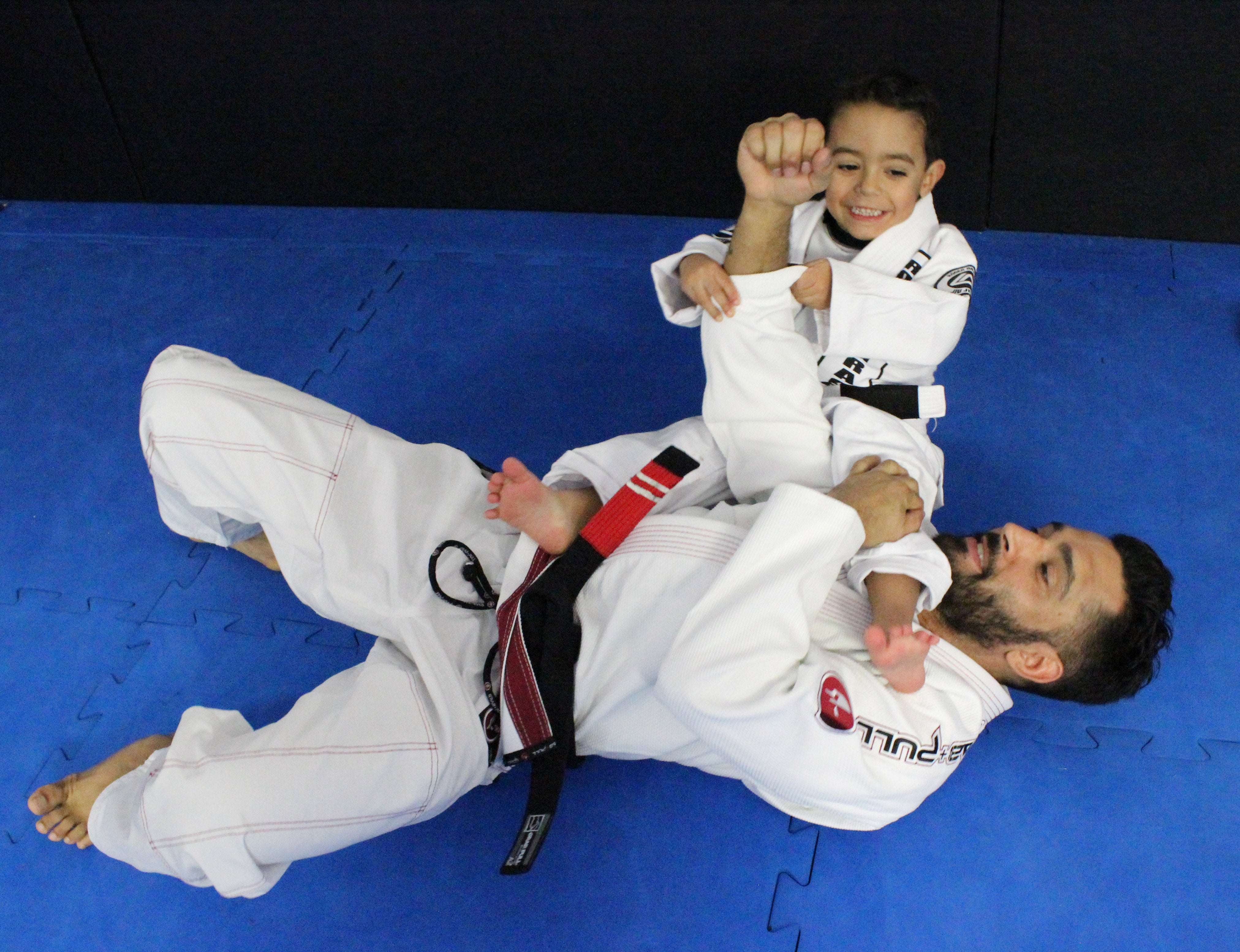 BJJ Instructor with Child Student