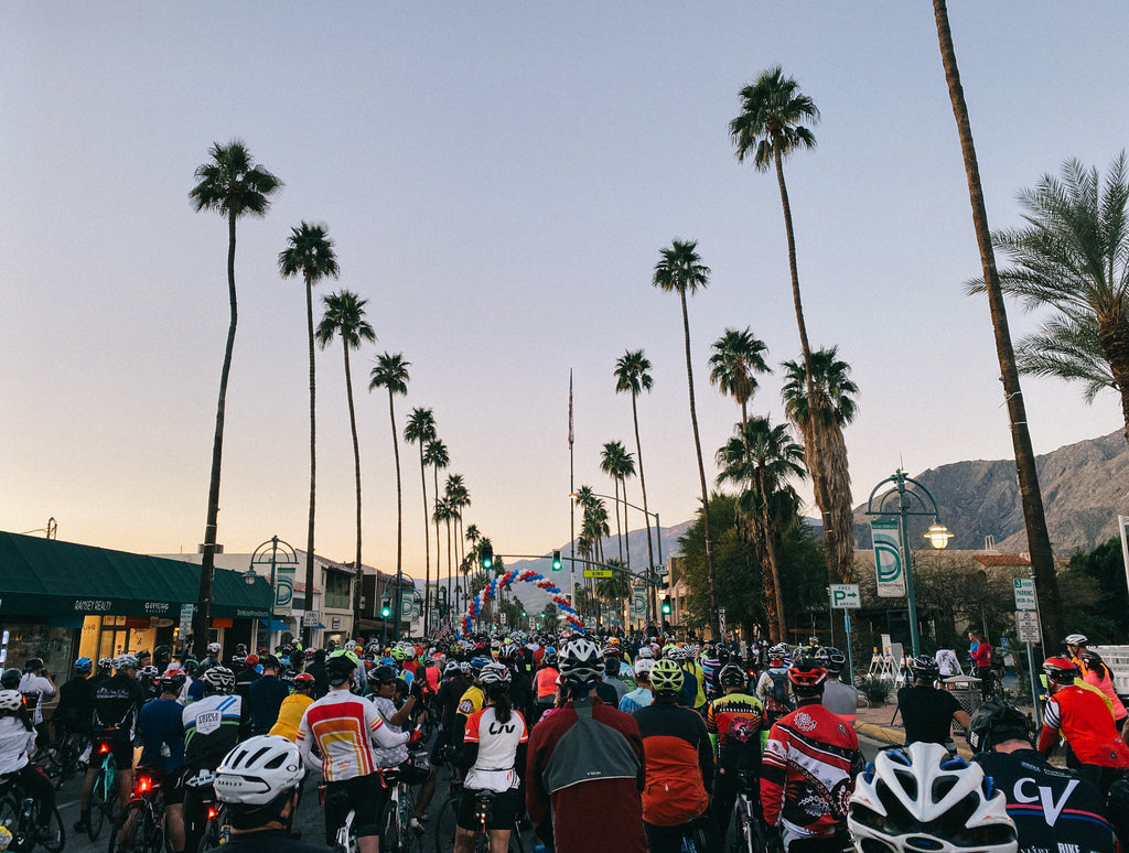 Riders line up at the start of the tour de palm springs.