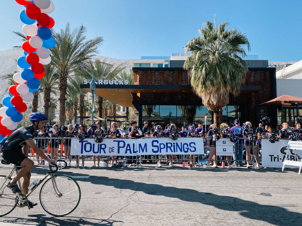 Cyclist crosses the finish line at Tour de Palm Springs.