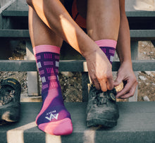 Load image into Gallery viewer, Purpel socks getting ready to ride