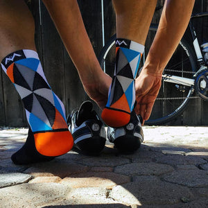 Cyclist gets ready to ride wearing Triangulate socks