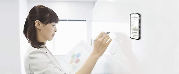 Woman working on whiteboard with Nano Suction iPhone Case