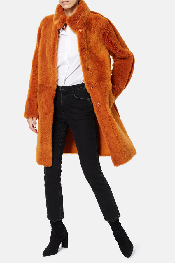 Manteau en fourrure orange