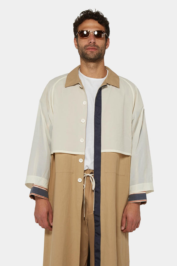 Manteau beige à empiècements superposés  Attachment