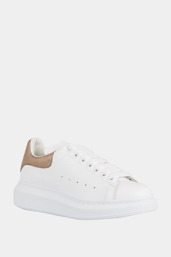 Alexander McQueen Baskets basses blanches et or rose