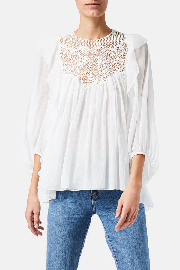 Blouse à broderies blanche