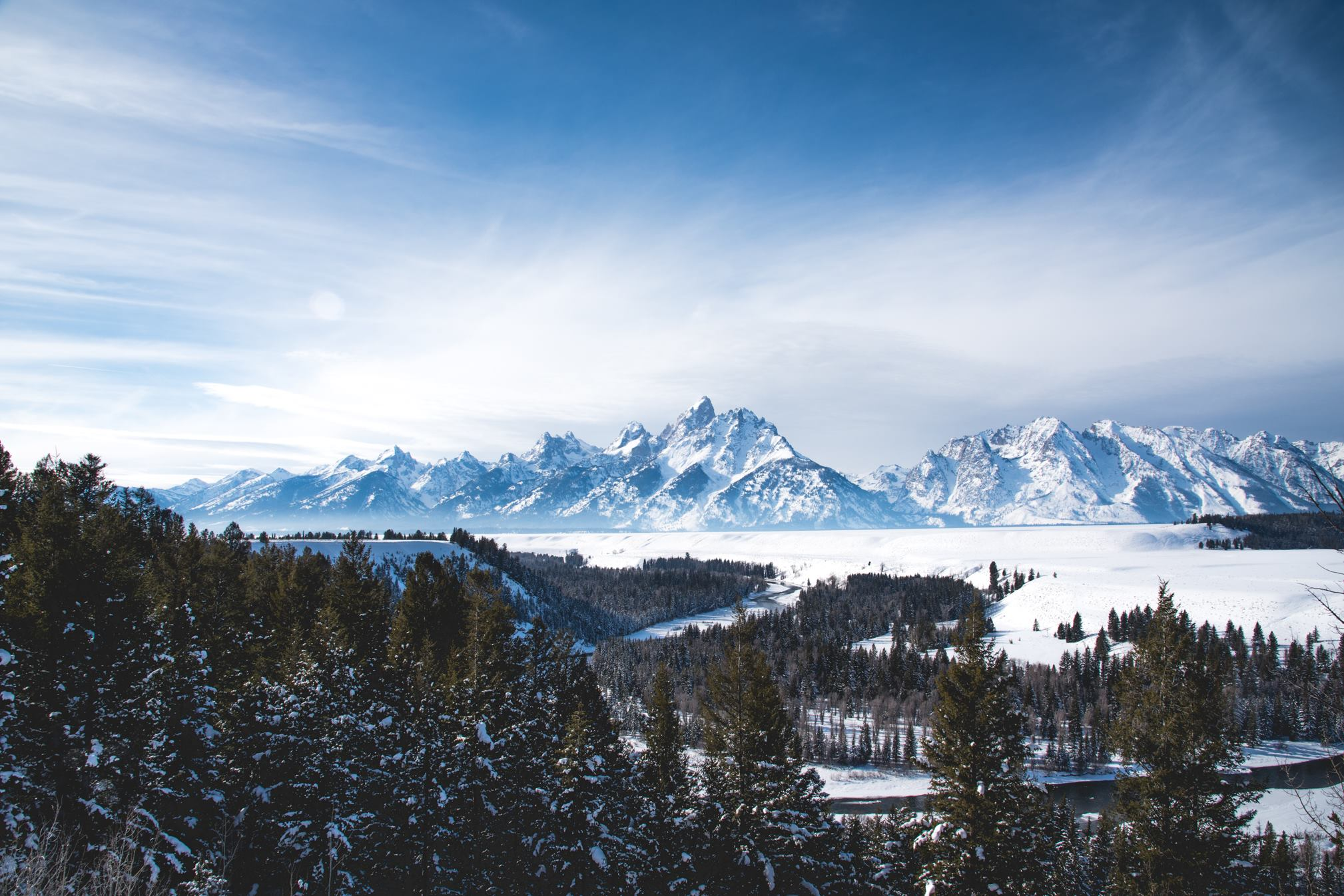 Blue, wintery image of the Tetons.