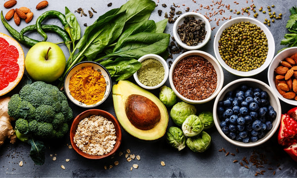 healthy-foods-spread-out-on-a-table-including-fruits-vegetables-grains-and-spices