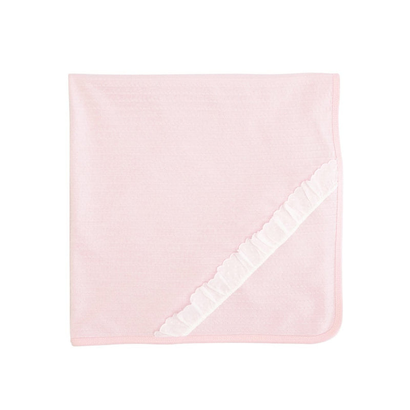 A pink textured reversible blanket
