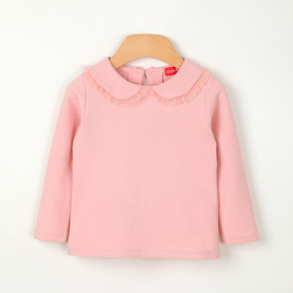 A pink long sleeves shirt