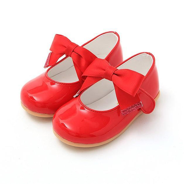 Red ballerinas with ribbon