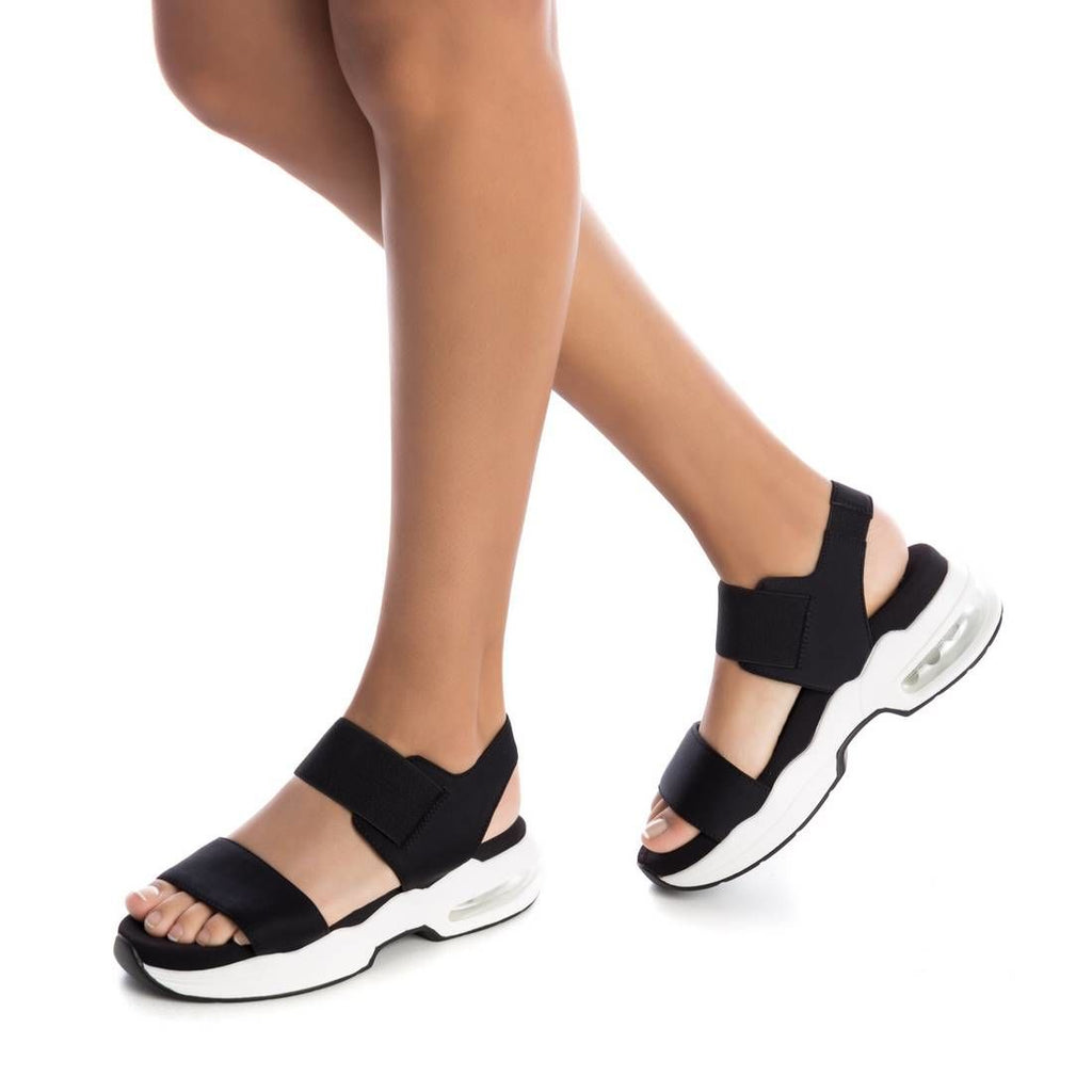 Xti Womens Faux Snake Print Perspex Heel black Sandals featuring a stretchy elastic band with velcro closure and the chunky elevated 4cm sole and air chamber will have you riding high in style. Pure trend for summer.