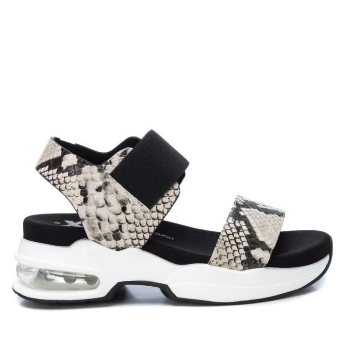 Xti Womens Faux Snake Print Perspex Heel taupe Sandals featuring a stretchy elastic band with velcro closure and the chunky elevated 4cm sole and air chamber will have you riding high in style. Pure trend for summer.