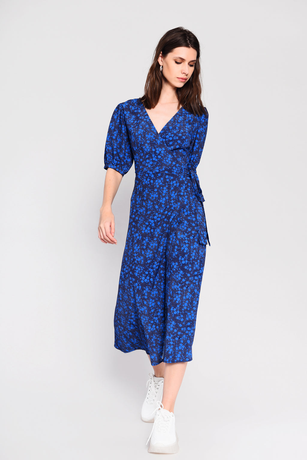 Blue ditsy floral wrap midi dress.