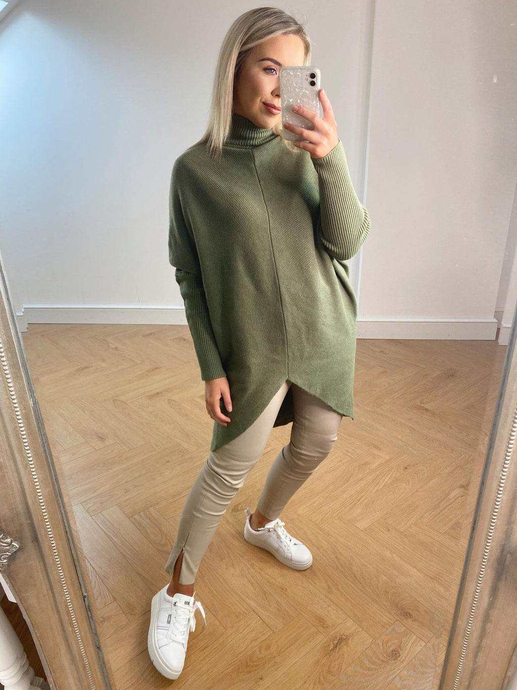 This jumper dress ticks all the boxes. They can be easily worn for a casual look with leggings, or with tights and boots. You decide.  Polo Neck  Batwing Sleeve One Size  One Size - 8 - 16