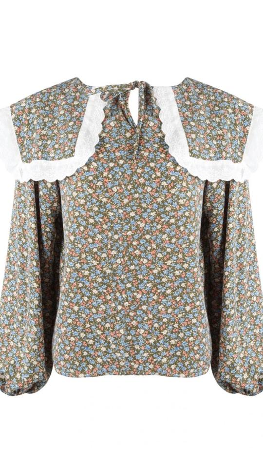 Check out this cute ditsy floral with a stand out collar. Its all about the cute florals this summer. Perfect paired with denim.