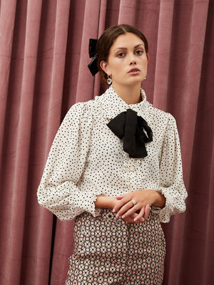 Sister Jane Puff sleeve shirt in a soft touch polka dot fabric. Featuring a removeable necktie in contrast fabric. Ruffles detail the collar, placket and cuffs.