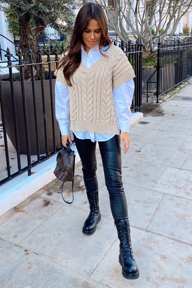 Girl in Mind Pippa Cable Knit Vest in the colour stone Featuring thick cable knit, v neck and a longline dropped back hem.