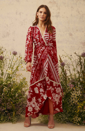 Hope & Ivy hand designed pinks red and cream floral print maxi wrap dress with v neck and long sleeves.