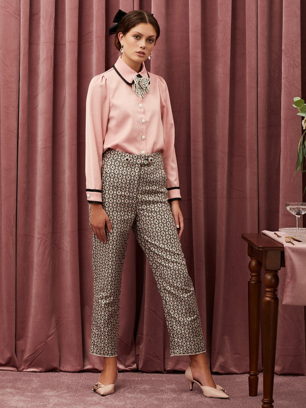 Sister Jane Tapered trousers in a tile jacquard design. Featuring stand out gem buttons on the waistband and a gem trim at the leg opening. This style is lined in a satin feel fabric.