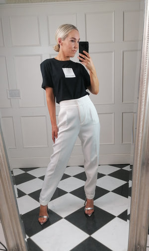 High-rise waist off white trousers with Zip fly and double hook and eye fastening, and side pockets with back welt pocket on the right side.