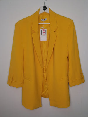 Canary yellow Blazer with rolled-up sleeves .