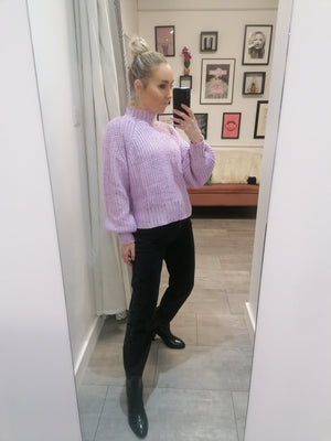 High neck High neck lilac knit sweater with with multi coloured speckles throughout.