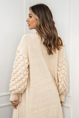 Add style to your cosy knitwear collection with our beautiful Kendall cardigan. This longline cardi features long bobble balloon sleeve, ribbed detailing all over with a contrasted hem. Pair with jeans and trainers or leather look trousers and heels for a more glam look.