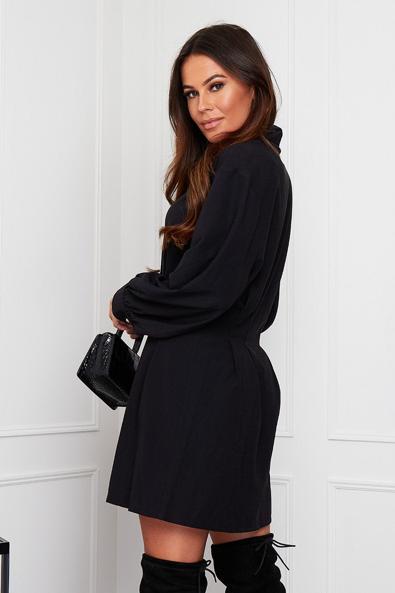 "Be a chic queen in our Maeve shirt dress. Featuring relaxed puff long sleeves with a fitted cuff, a pleated fitted waist, buttons to the front and a shirt collar. This understated dress looks great with boots, trainers and heels, pair with your fave clutch for a stylish but casual look.   Model wears a UK 8 and is 5'7""."