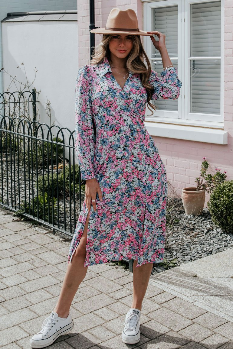 "Give your weekend attire an upgrade with our new Rose dress. Featuring a shirt collar, wrap front, cinched in waist and long cuffed sleeves. Pair with trainers or heels depending on your occasion.   Model wears a UK 8 and is 5'6""."