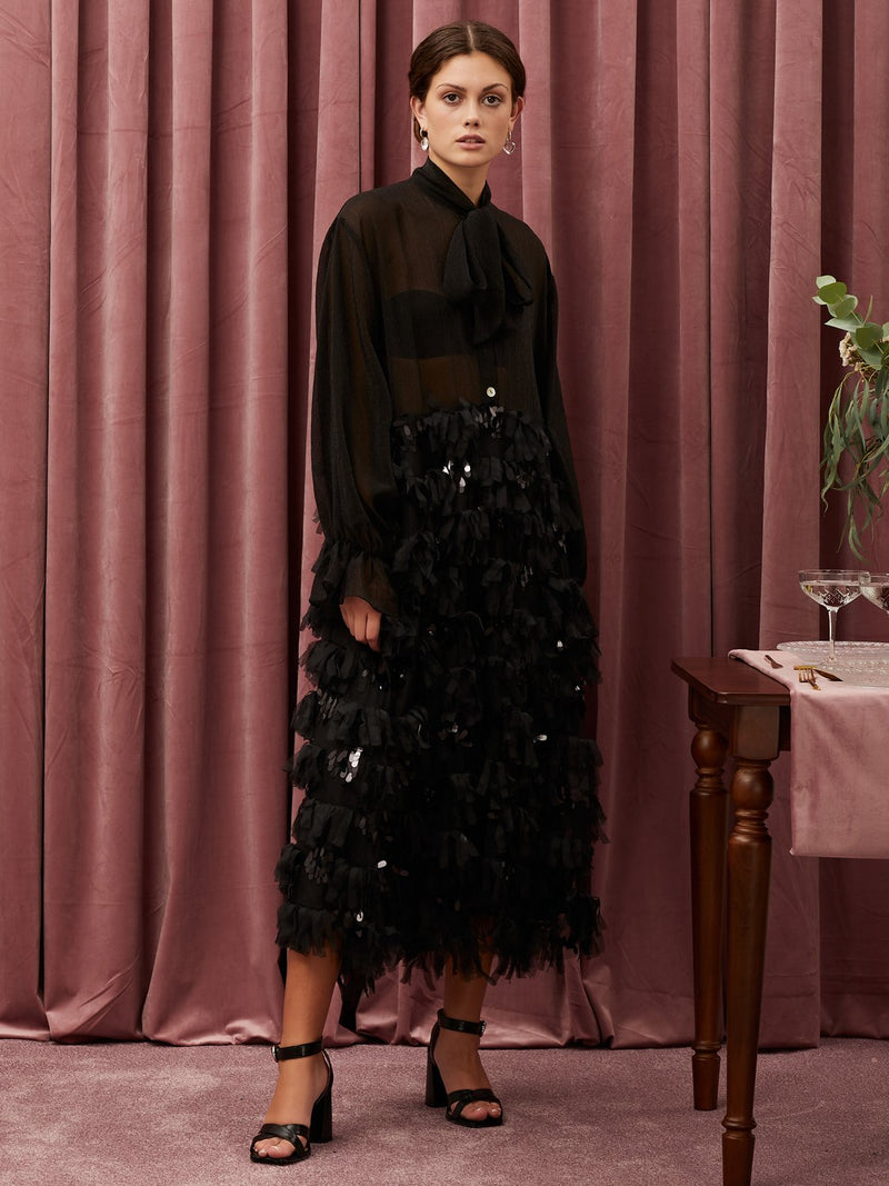 Sister Jane Oversized midi dress in mixed fabrication. Featuring a stand out ruffled sequin skirt and a lightweight textured bodice fabric. An oversized neck tie completes the look.