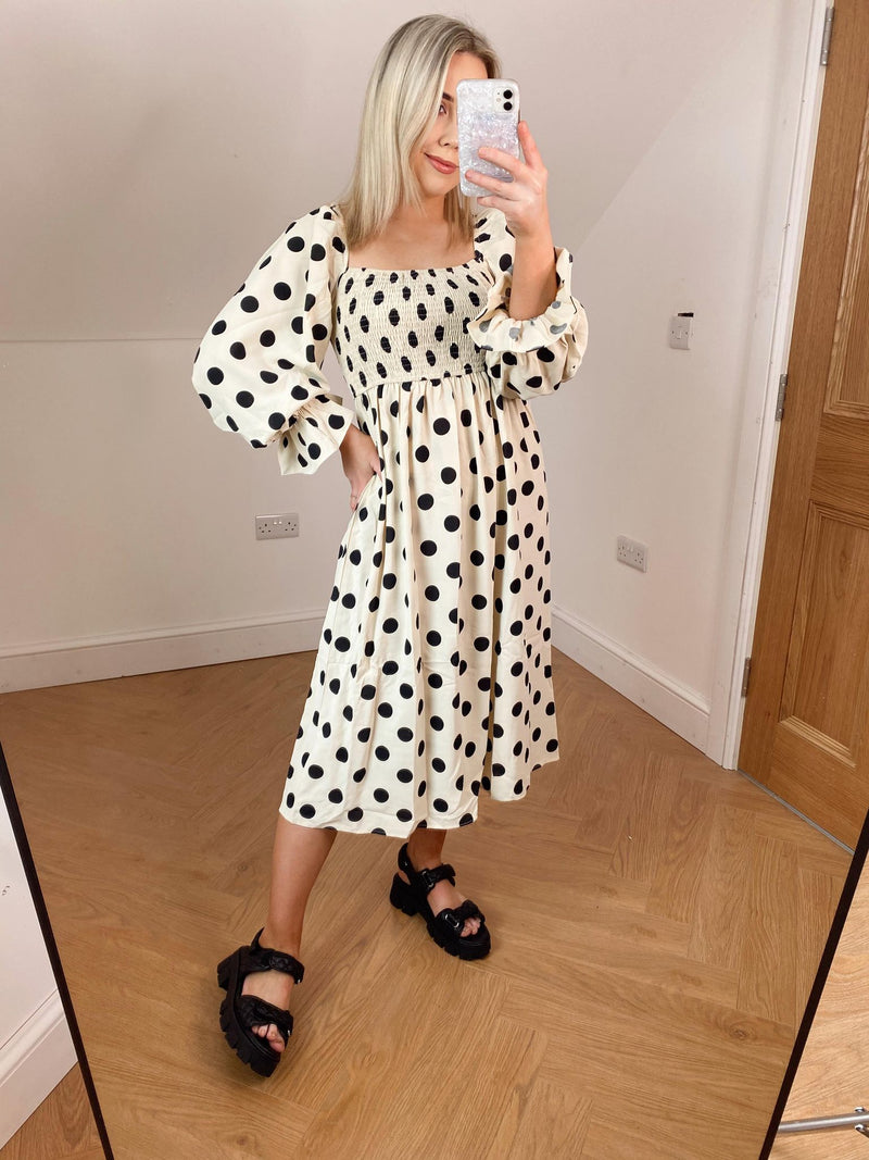 Stand out in this beautiful Polka Dot Midi Dress!  Midi Length with bell sleeves, looks great paired with chunky black sandals or why not go all out with a heel!   Model wears size small