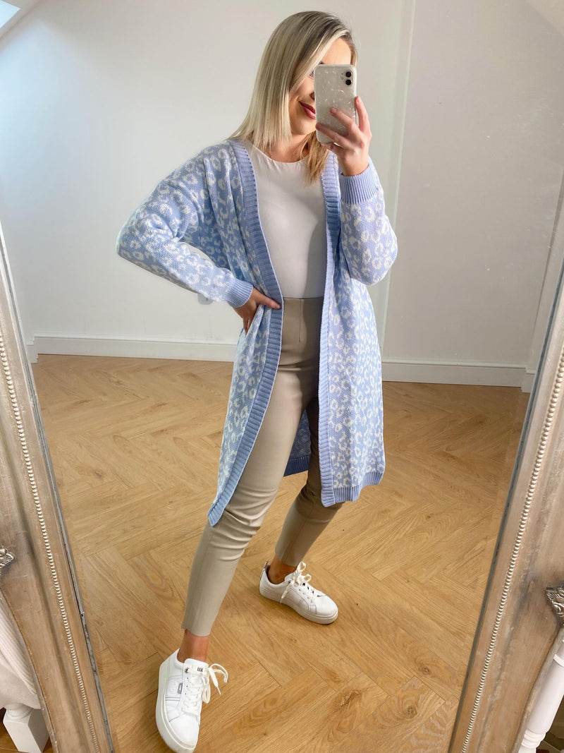Complete your cozy collection with our super cute Vicky cardigan. Featuring long sleeves, an open front, a ribbed hem and an animal print. Pair with jeans and trainers for a casual look or over a cute mini dress and boots for dressy vibes! This cozy versatile cardigan is the perfect WFH companion!  Model wears OneSize and is 5'4