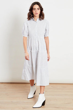 Because who doesn't love a crisp white shirt dress?  This beautiful shirt dress with tiers is a staple in your wardrobe, featuring button detail right up to the neck. With slight balloon sleeve this dress can be dressed up or down for S/S 21. Perfect paired with trainers for that casual look or dressed up with heels.   Tiered Effect Polka Dot Midi Dress