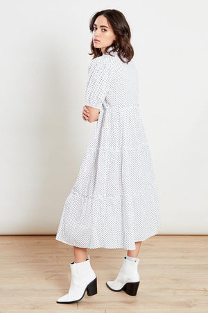 Because who doesn't love a crisp white shirt dress?  This beautiful shirt dress with tiers is a staple in your wardrobe, featuring button detail right up to the neck. With slight balloon sleeve this dress can be dressed up or down for S/S 21. Perfect paired with trainers for that casual look or dressed up with heels.   Tiered Effect Polka Dot Midi Dress#