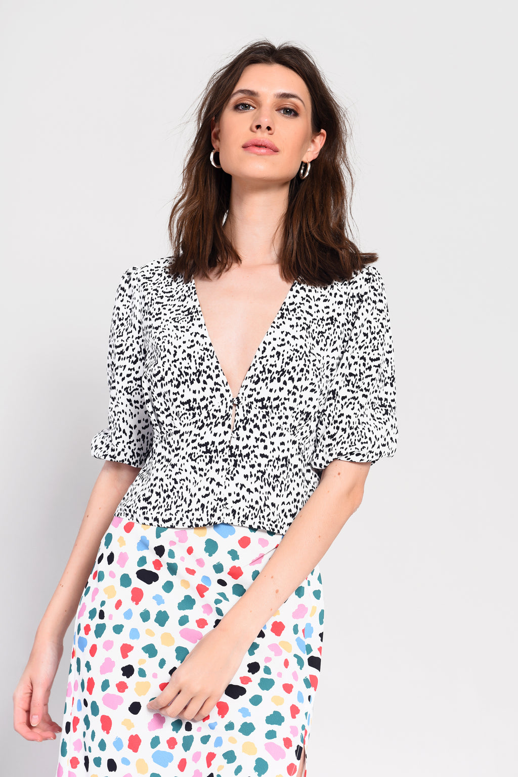 Glamorous mini dalmatian print top with short sleeves, v-neck featuring button down front.