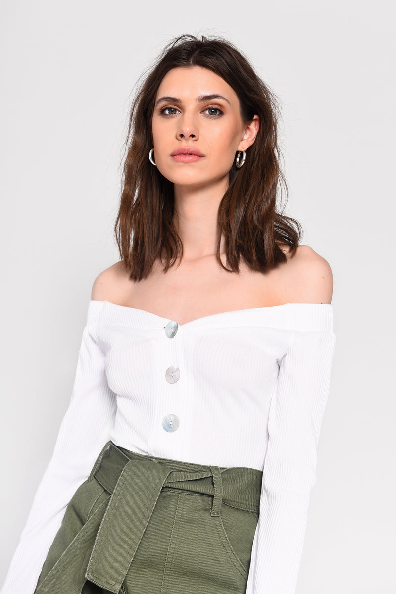 Glamorous Women's white rib long sleeve bodysuit. Everyone needs a white rib bodysuit in their wardrobe this season. Featuring an off shoulder and front button detailing.