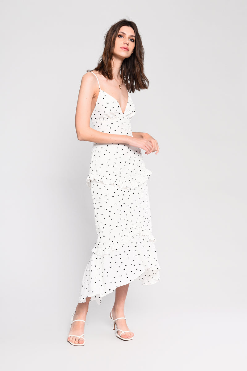 Glamorous white cami midi dress with black heart print and fishtail hem detail.