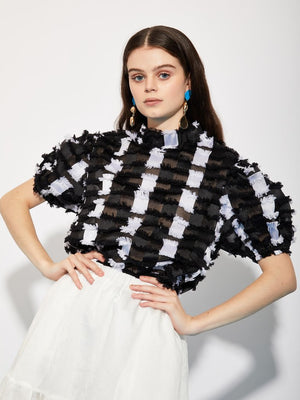 Sporty checkered black and white top from Ghospell. Semi-sheer with 3D detailing and puffed sleeves, this is an excellent addition to any capsule wardrobe.