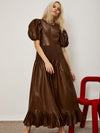 Ghospell Puff sleeve maxi dress in a soft faux leather fabric. Featuring a shirred waist and pleated hem.